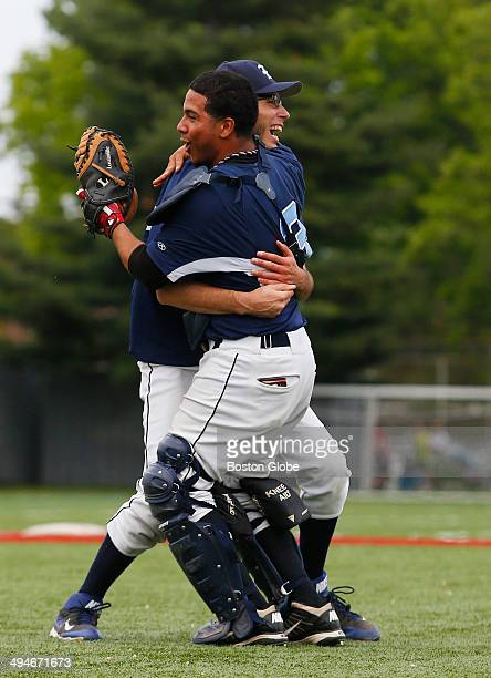 Boston English High catcher Miguel Calderon right and pitcher Alberto Navarro celebrate their win over Boston International High to take the City...