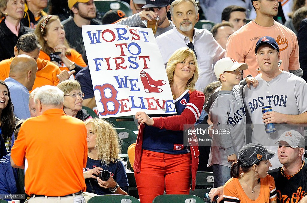 A Boston fan holds up a sign during the game between the Boston Red Sox and the Baltimore Orioles at Oriole Park at Camden Yards on September 27, 2013 in Baltimore, Maryland.