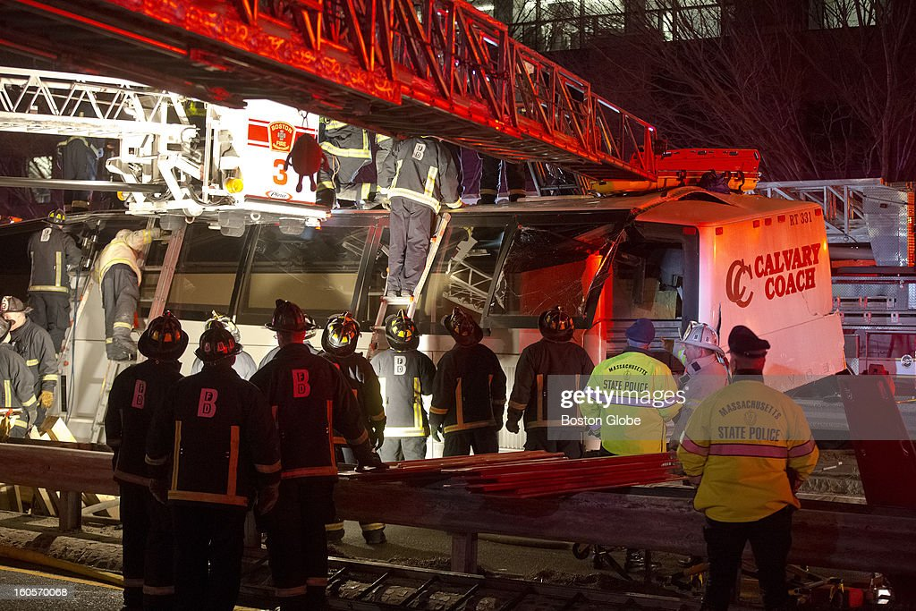 Boston Fire and Emergency personnel rescue injured passengers on a bus that crashed driving under the Western Avenue Bridge on Soldiers Field Road on Saturday, Feb. 2, 2013. High school students and their adult chaperones with the Bristol, Pa.-based Destined for a Dream Foundation group were on a charter bus after a visit to Harvard University when the oversized bus crashed into a bridge. More than 30 people were injured.