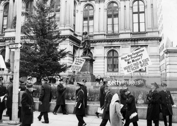 Boston firemen picket outside city hall over salary negotiations with Mayor White in Boston Dec 16 1968