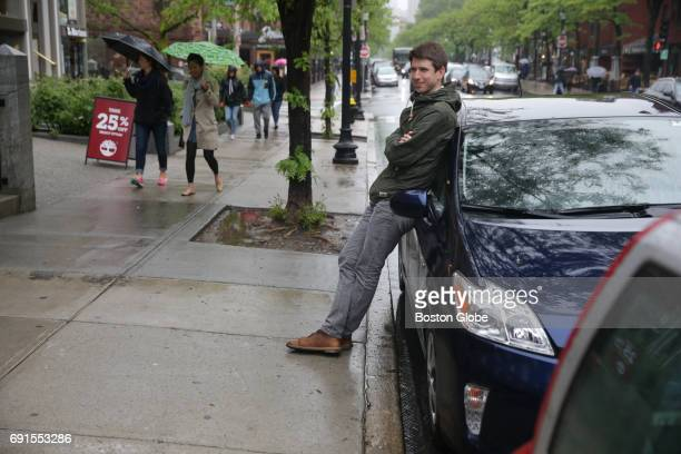 Boston Globe Reporter Dugan Arnett poses with a Toyota Prius rented through the Getaround App in Boston on May 25 2017 Getaround is a peertopeer car...