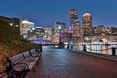 Boston Harbor and Financial District at dusk in Boston, Massachusetts.