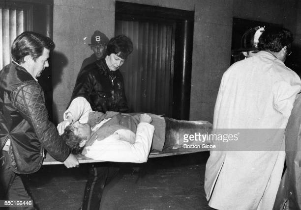 Boston MA 4/22/1976 A victim is carried out on a stretcher by authorities after a bomb exploded inside the Suffolk County Courthouse in Boston April...