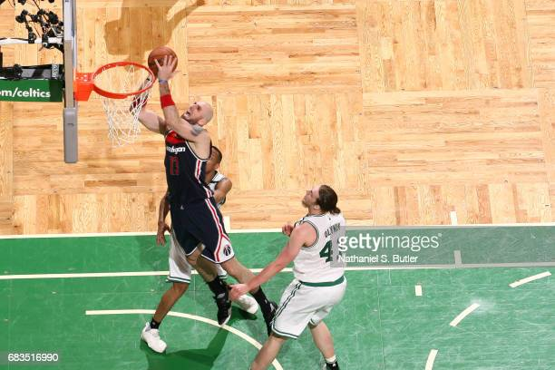 Marcin Gortat of the Washington Wizards shoots the ball against the Washington Wizards during Game Seven of the Eastern Conference Semifinals of the...