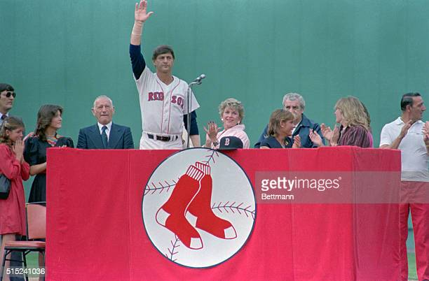 Red Sox Star Carl Yastrzemski waves to fans as he is honored during 'Yaz Day' retirement ceremony at Fenway Park Seated Yastrzemski's dad Carl Sr...