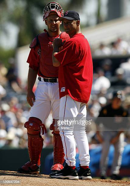 Boston manager Terry Francona makes a pitching change as catcher Josh Bard looks on during Saturday's game at City of Palms Park in Ft Myers Florida...