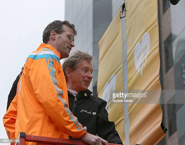 Boston Marathon banners being hung near the finish line Bill Rogers with Shane O'Hara up on a lift