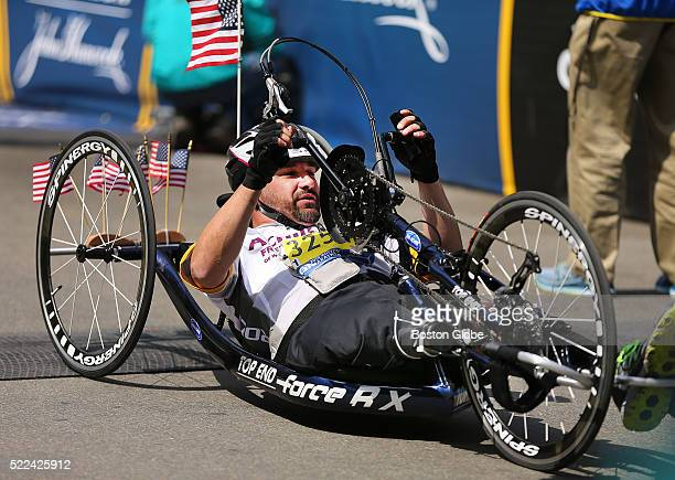 Boston Marathon bombing survivor Mark Fucarile powers his bike across the finish line of the 120th Boston Marathon on Monday April 18 2016