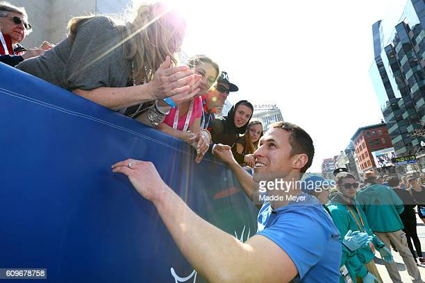 Boston Marathon bombing survivor Patrick Downes celebrates after finishing the 120th Boston Marathon on April 18 2016 in Boston Massachusetts