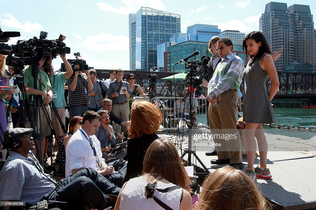 Boston Marathon bombing survivors left to right Henry Borgard Scott Weisberg and Lynn Julian talk with the press outside the Moakley federal...