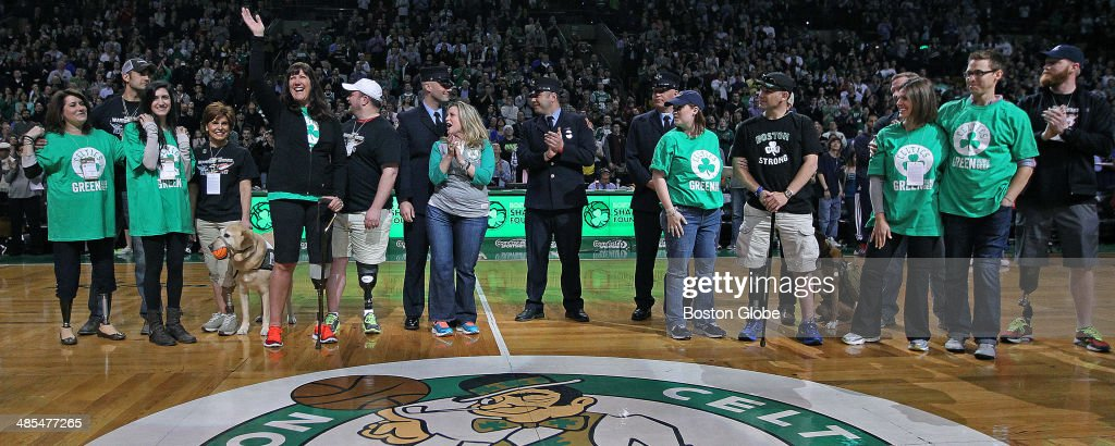 Boston Marathon bombing survivors were honored at mid court following the end of the first quarter. The Boston Celtics hosted the Washington Wizards in their final NBA game of the season at the TD Garden on Wednesday, April 16, 2014.
