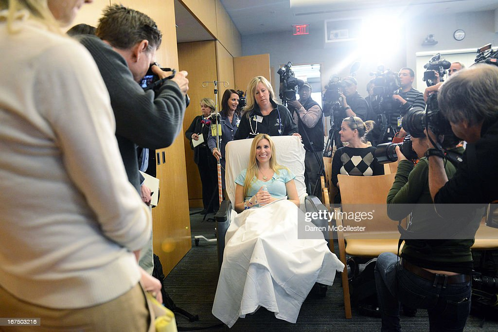 Boston Marathon bombing victim Heather Abbott of Newport, Rhode Island is wheeled into a press conference at Brigham and Women's Hospital April 25, 2013 in Boston, Massachusetts. Abbot had her left leg amputated several inches below the knee after because the injuries sustained after the blast.