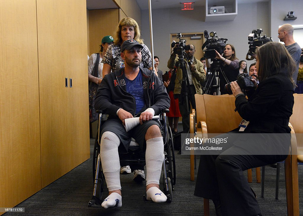 Boston Marathon bombing victim Jarrod Clowery of Stoneham, Massachusetts is wheeled into a press conference at Brigham and Women's Hospital April 30, 2013 in Boston, Massachusetts. Clowery was watching the marathon with a group of friends when the second bomb went off, burning his back, arms, and legs, and embedding shrapnel into his body that was later removed by physicians.