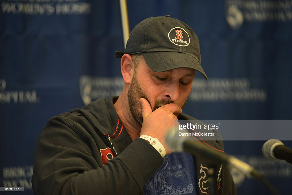 Boston Marathon bombing victim Jarrod Clowery of Stoneham, Massachusetts pauses as he describes his ordeal during a press conference at Brigham and Women's Hospital April 30, 2013 in Boston, Massachusetts. Clowery was watching the marathon with a group of friends when the second bomb went off, burning his back, arms, and legs, and embedding shrapnel into his body that was later removed by physicians.