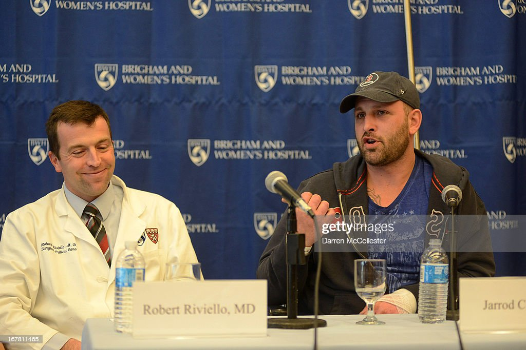 Boston Marathon bombing victim Jarrod Clowery of Stoneham, Massachusetts shares a light moment with his physician, Dr. Robert Riviello during a press conference at Brigham and Women's Hospital April 30, 2013 in Boston, Massachusetts. Clowery was watching the marathon with a group of friends when the second bomb went off, burning his back, arms, and legs, and embedding shrapnel into his body that was later removed by physicians.