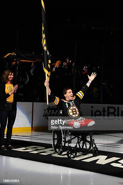 Boston Marathon bombing victim Jeff Bauman waves the fan banner before the game of the Boston Bruins against the Toronto Maple Leafs in Game Two of...