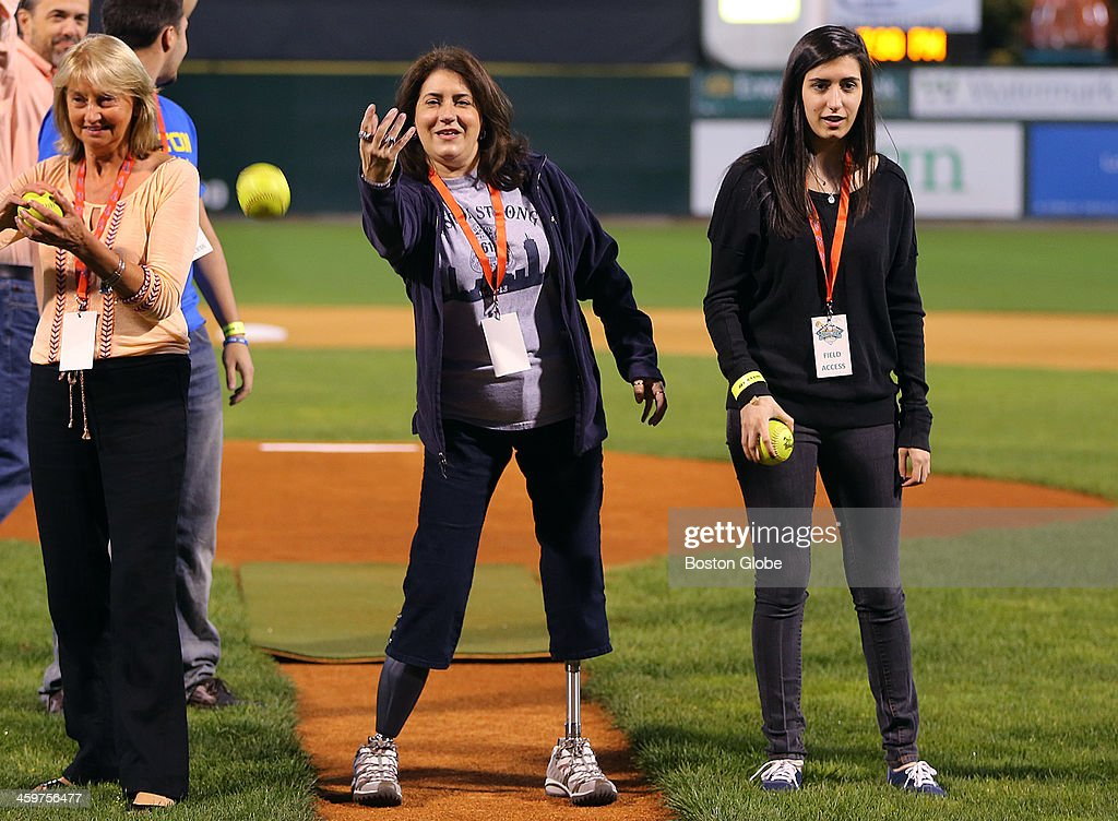 Boston Marathon bombing victims Celeste Corcoran and daughter Sydney threw out the first pitch at Bruins player Milan Lucic's Rock & Jock charity softball game at Lowell stadium.