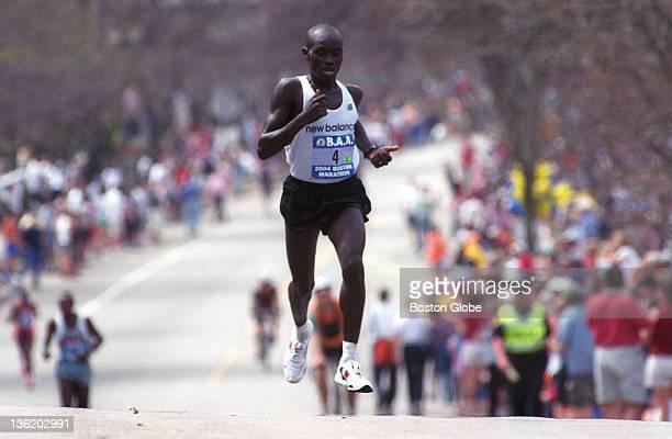 Boston Marathon men's winner Timothy Cherigat is all alone as he climbs Heartbreak Hill