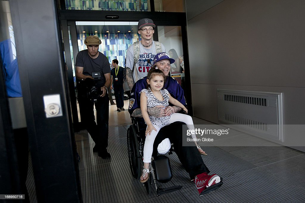 Boston Marathon survivor Paul Norden is wheeled out by his brother Jonathan while he held his five-year-old niece Gabbie Ferullo. Paul Norden was discharged from Spaulding Rehabilitation Hospital in Charlestown, Mass. on Thursday, May 16, 2013.