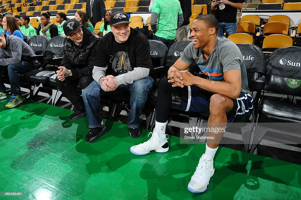 Boston Marathon survivor, Paul Nordren and friend, chat with Russell Westbrook #0 of the Oklahoma City Thunder before the game against the Boston Celtics on January 24, 2014 at the TD Garden in Boston, Massachusetts.