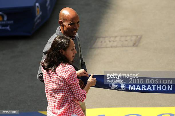 Boston Marathon winner Meb Keflezighi waits for the Men's Elite division winner to cross the finish line during the 120th Boston Marathon on April 18...