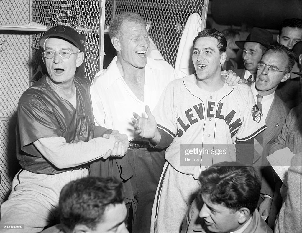 President Bill Veeck of the Cleveland Indians splits his face in a hearty guffaw as he congratulates Manager Lou Boudreau (right) after his Indians won the World Series Pennant in Boston by trimming the Braves 4-3. The open-mouthed celebrant at left is coach Bill Mackechnie. And it seems that it was only yesterday that Veeck was toying with the idea of firing Boudreau, and would have it the Cleveland fans hadn't reared to their hind legs in revolt.