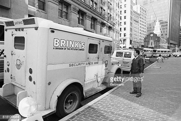 A passerby looks at the Brink's armored car that was held up by three men one with a sawedoff shotgun The robbed the armored car guards and escaped...