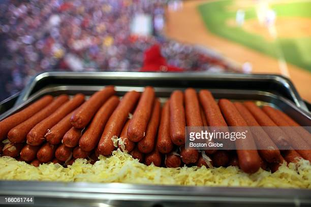 Boston Mayor M Thomas Menino escorted by Red Sox president Larry Lucchino during the annual preopening day tour at Fenway Park Fenway Franks being...