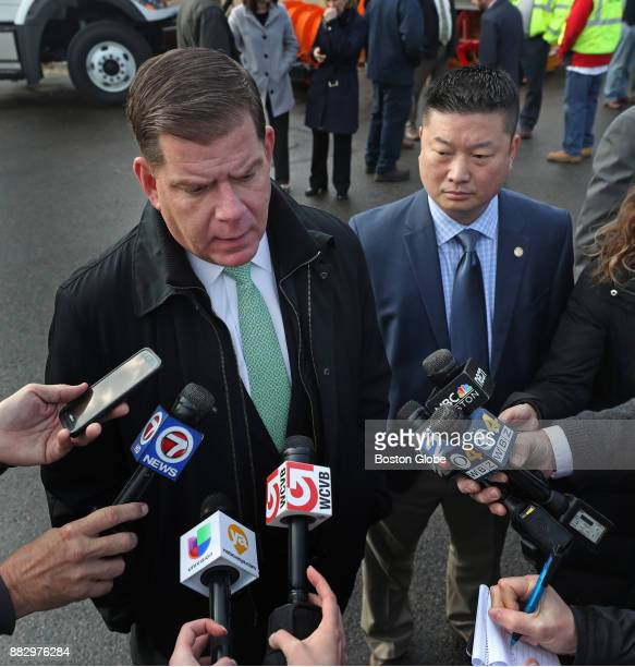 Boston Mayor Martin J Walsh left answers questions from the media with Boston Public Schools superintendent Tommy Chang right regarding the...
