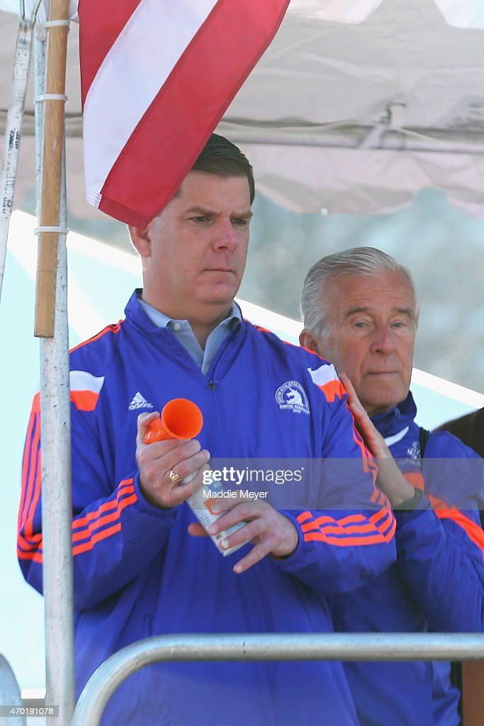 Boston Mayor Martin J. Walsh sounds a horn to signal the start of the second wave of runners during the B.A.A. 5k on April 18, 2015 in Boston, Massachusetts.