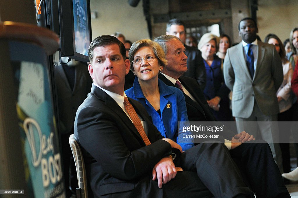 Boston Mayor Martin J. Walsh (L), U.S. Sen. Elizabeth Warren (D-MA) (2nd L) and U.S. Sen. Edward Markey (D-MA) (3rd L) attend an opening for a new Boston Marathon memorial exhibition, 'Dear Boston: Messages from the Marathon Memorial,' at the Boston Public Library April 7, 2014 in Boston, Massachusetts. Three spectators were killed and more than two hundred sixty injured when two bombs exploded on Marathon Monday, which prompted a massive manhunt for suspects later identified as Tamerlan and Dzhokhar Tsarnaev, two brothers from Chechnya, living in Cambridge, Massachusetts. Photo by Darren McCollester/Getty Images)