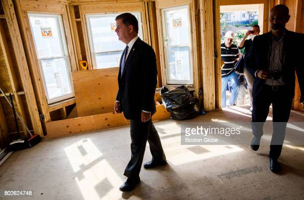 Boston Mayor Mary Walsh walks through a house being renovated for affordable housing in Boston on Jun 9 2017