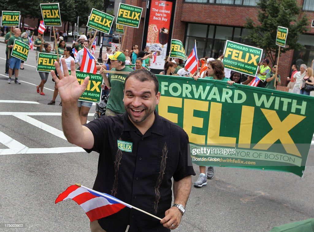 Boston mayoral candidate Felix Arroyo marches in the Puerto Rican Day parade, making a big push for the Latino vote. The Puerto Rican Day parade and festival is held on Sunday, July 28, 2013, ending at Boston City Hall Plaza, instead of the usual Franklin Park.