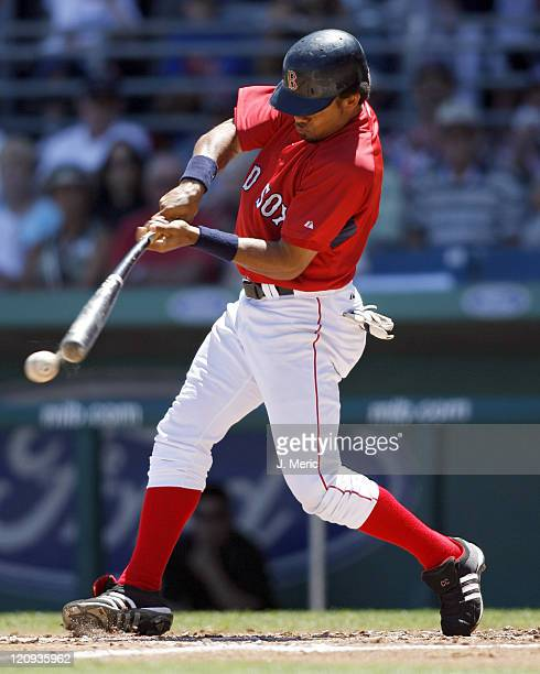 Boston outfielder Coco Crisp makes contact on a pitch in Sunday's game against Florida at City of Palms Park in Ft Myers Florida on March 25 2007