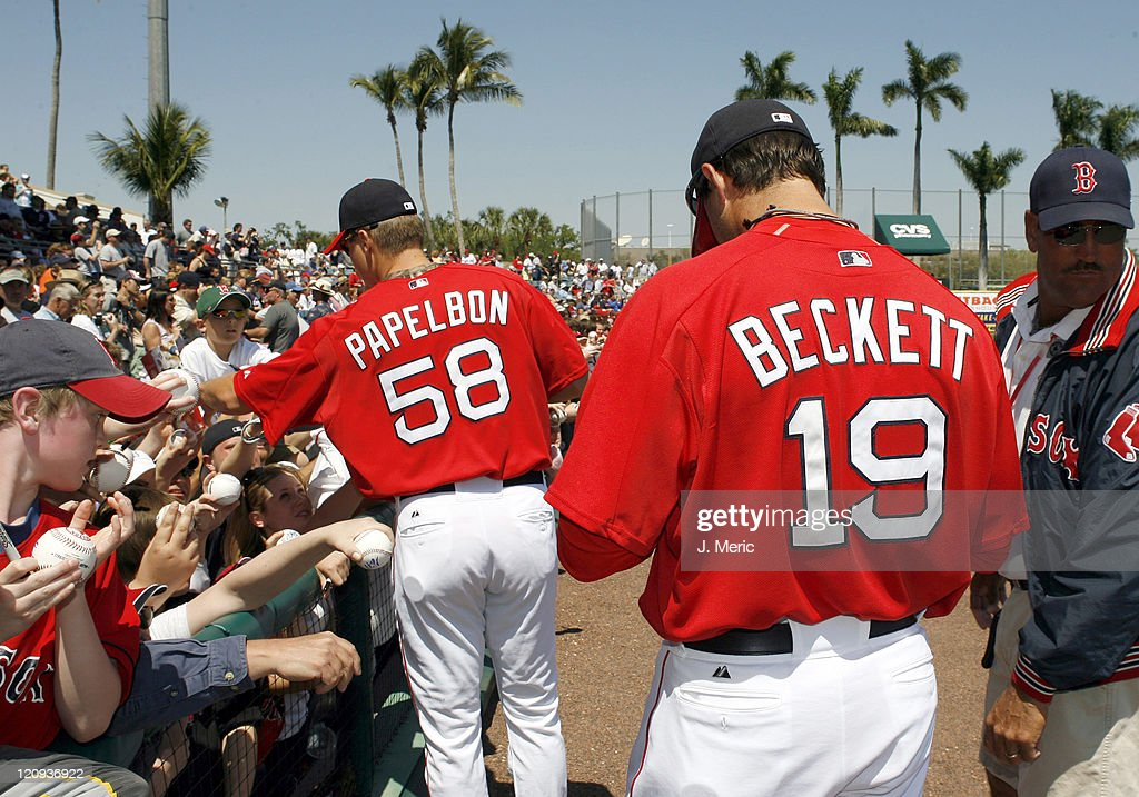 Boston pitchers Jonathan Papelbon and Josh Beckett sign autographs prior to Saturday's game against Toronto at City of Palms Park in Ft Myers Florida...