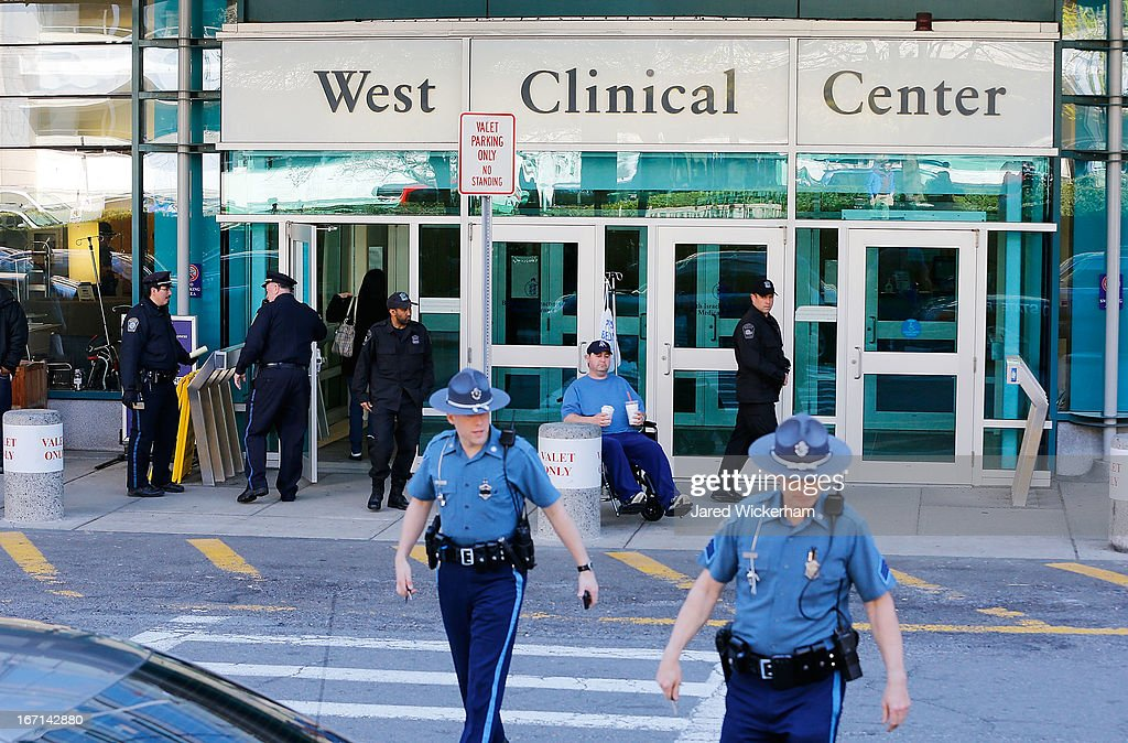 Boston Police and Massachusetts State Police stand guard outside of Beth Israel Deaconess Medical Center, where the Boston Marathon bombing suspect, Dzhokhar A. Tsarnaev, 19, is currently being held and receiving medical attention, on April 21, 2013 in Boston, Massachusetts. A manhunt for Dzhokhar A. Tsarnaev, 19, a suspect in the Boston Marathon bombing ended after he was apprehended on a boat parked on a residential property in Watertown, Massachusetts. His brother Tamerlan Tsarnaev, 26, the other suspect, was shot and killed after a car chase and shootout with police. The bombing, on April 15 at the finish line of the marathon, killed three people and wounded at least 170.