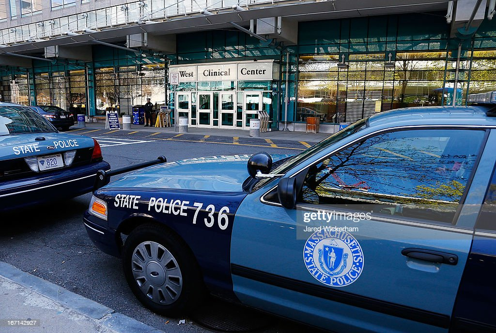 Boston Police and Massachusetts State Police stand guard outside of Beth Israel Deaconess Medical Center where the Boston Marathon bombing suspect...