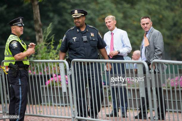 Boston Police Chief William Gross second from left Boston Police Commissioner William Evans second from right with other officers along barricades on...