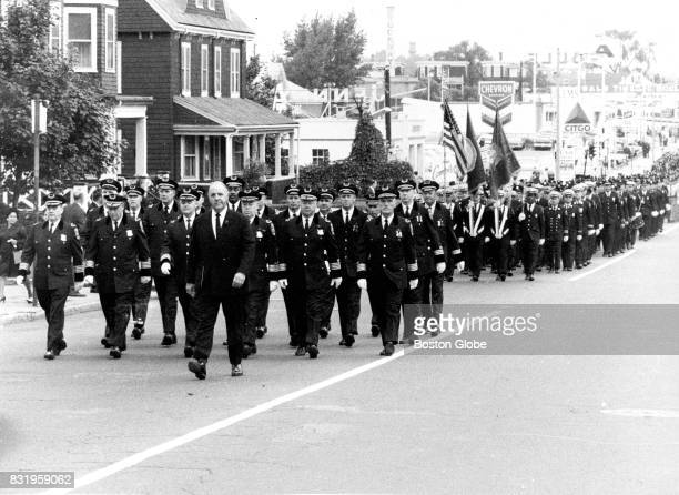 Boston Police Commissioner Edmund McNamara leads the funeral march during services for Boston Police officer Walter A Schroeder killed in the line of...