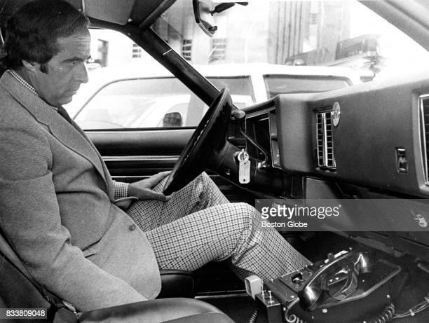 Boston Police Commissioner Robert diGrazia sits in a new Boston Police cruiser on Jul 30 1974