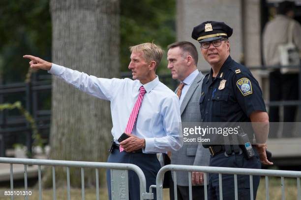 Boston Police Commissioner William Evans left with other officers along barricades on the Boston Common where a 'Free Speech' rally is scheduled and...