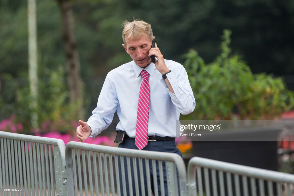 Boston Police Commissioner William Evans talks on the phone along barricades on the Boston Common where a 'Free Speech' rally is scheduled and a large rally against hate in solidarity with victims of Charlotestville will converge Saturday, on August 18, 2017 in Boston, Massachusetts.
