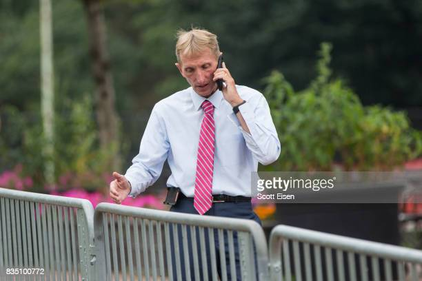 Boston Police Commissioner William Evans talks on the phone along barricades on the Boston Common where a 'Free Speech' rally is scheduled and a...