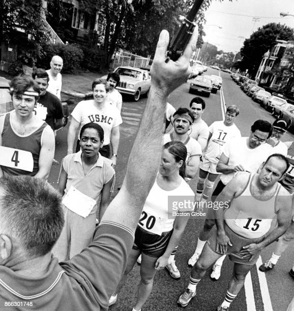 Boston Police Detective Frank Olbrys holds up the 38 caliber starter's pistol to kick off the Boston Police road race outside the District 11 station...