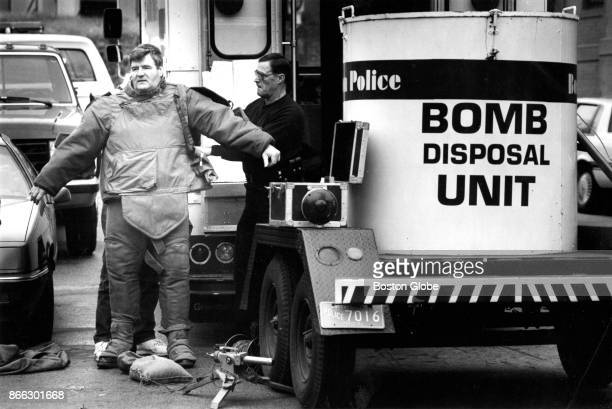 Boston Police officer Ed O'Toole a 5year veteran of the bomb squad suits up to approach a suspected explosive device on Walnut Avenue in the Roxbury...