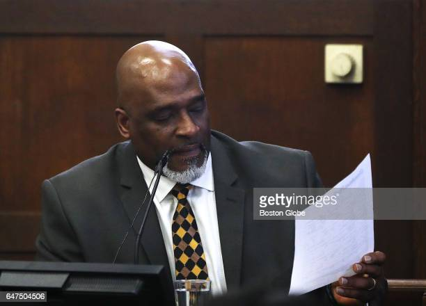 Boston Police Officer Erick K James studies a report while testifying during the double murder trial of former New England Patriots tight end Aaron...