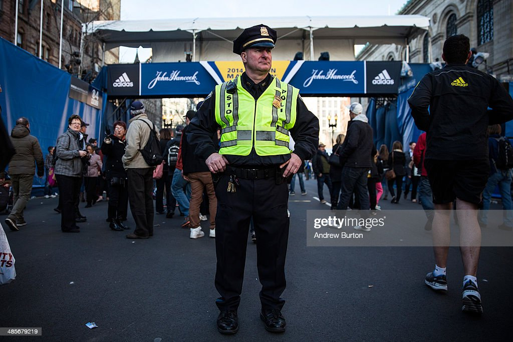 A Boston police officer stands guard near the finish line of the Boston Marathon on April 19, 2014 in Boston, Massachusetts. This year's marathon will be held on Monday, April 21; last year two pressure cooker bombs were detonated near the finish line, killing three people and injuring more than 260 others.