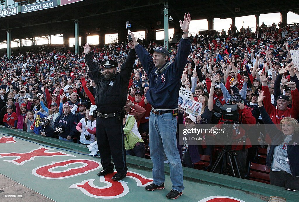Boston Police Officer Steve Horgan, known as the Boston Red Sox bullpen cop cheers along with the fans at Fenway Park before the Red Sox players board the duck boats for the World Series victory parade for the Boston Red Sox on November 2, 2013 in Boston, Massachusetts.