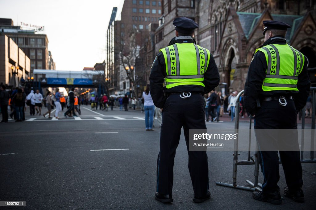 Boston police officers stand guard near the finish line of the Boston Marathon on April 19, 2014 in Boston, Massachusetts. This year's marathon will be held on Monday, April 21; last year two pressure cooker bombs were detonated near the finish line, killing three people and injuring more than 260 others.