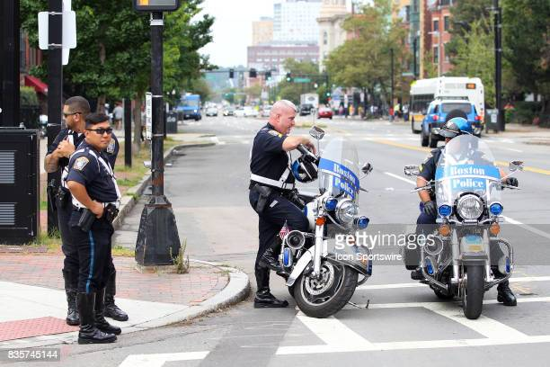 Boston Police officers waits for the counterprotestor march to begin during the Free Speech Rally on August 19 at Boston Commons in Boston MA